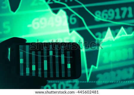 Working with digital tablet computer and smart phone with digital business strategy layer effect and the digital chart. Green Tone.