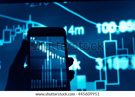 Working with digital tablet computer and smart phone with digital business strategy layer effect and the digital chart. Dark tone. - stock photo