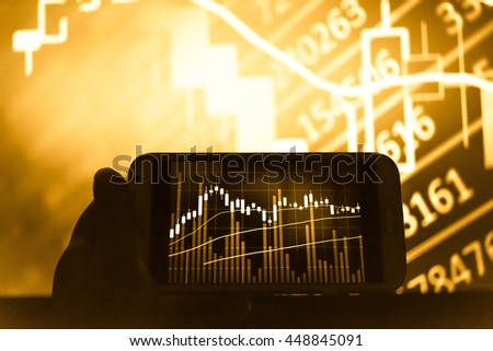 Working with digital tablet computer and smart phone with digital business strategy layer effect and the digital chart. Gold Tone. - stock photo