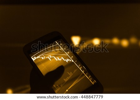 Working with digital tablet computer and smart phone with digital business strategy layer effect and the digital chart. Gold Tone.