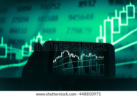 Working with digital tablet computer and smart phone with digital business strategy layer effect and the digital chart. Green Tone. - stock photo