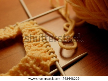 working with double pointed needles and ball of wool merino - stock photo