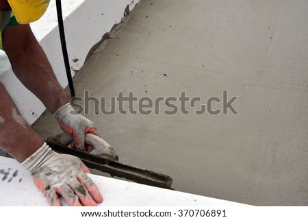 Working with lightweight cement in a planter - stock photo