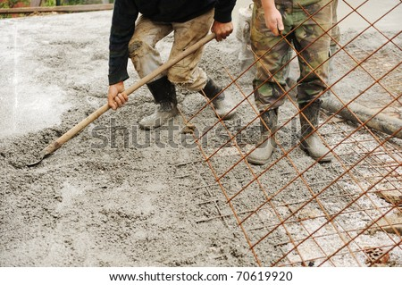 Working with stucco and cement outdoor - stock photo