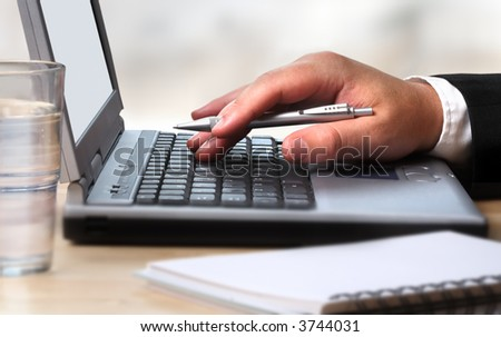 Working with the laptop - stock photo