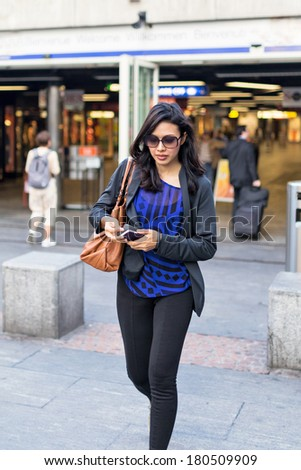 Working Woman Walking Along the Street in Downtown - stock photo