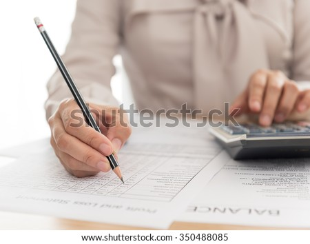 working women analysis business accounting with financial statement.  - stock photo