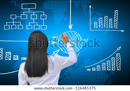 working women hand drawing business graph - stock photo