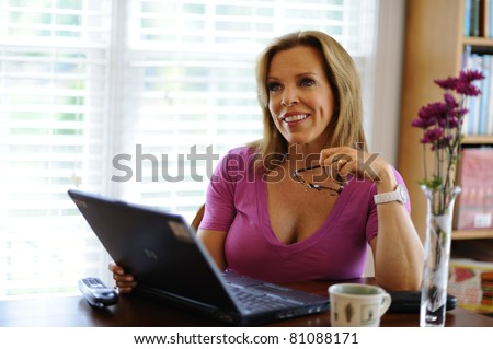 Working working at home based business - stock photo
