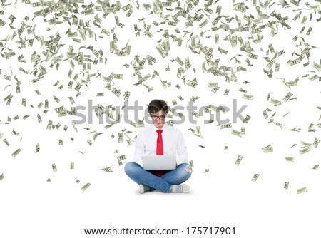 Working young man and one hundred dollars rain 2 - stock photo