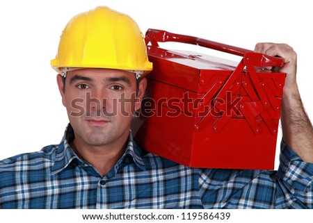 workman carrying toolbox - stock photo