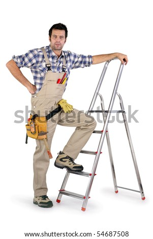 Workman leaning on a scale on white background - stock photo