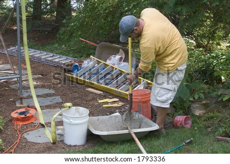 Workman Mixing Cement