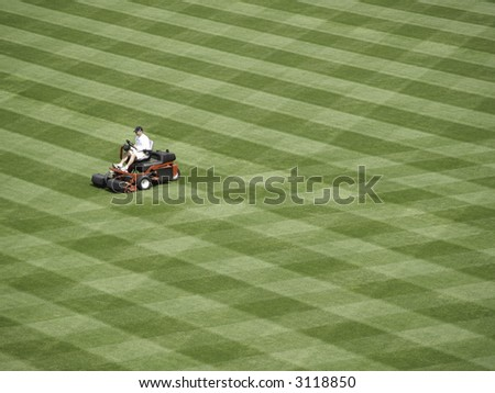 Workman readies a baseball field for the season. - stock photo
