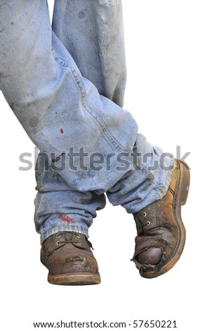 Workman's boots and jeans on a white background - stock photo