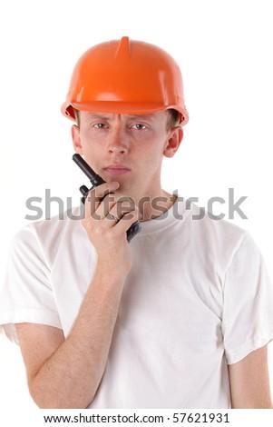 workman talking on portable UHF radio transceiver - stock photo