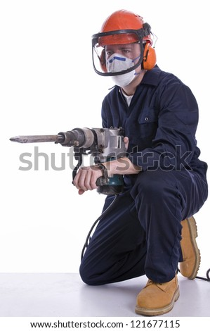 workman using pneumatic drill on white background - stock photo
