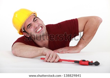 Workman with a wrench - stock photo