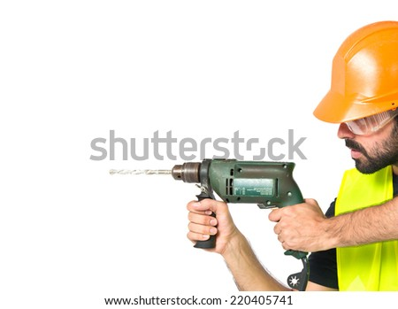 workman with drill over white background - stock photo