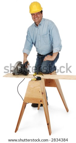 Workman with power saw kneeling on a saw horse shot on white background - stock photo