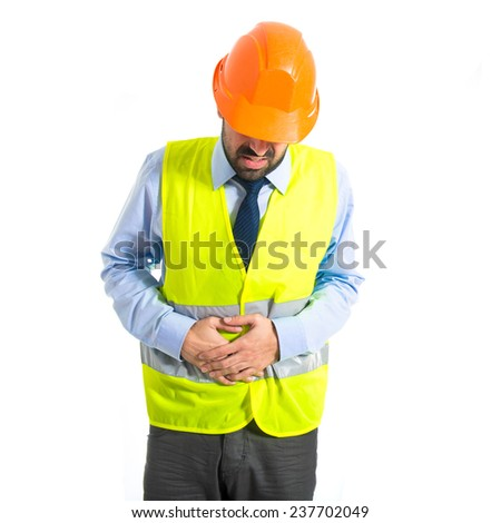 Workman with stomachache over white background - stock photo