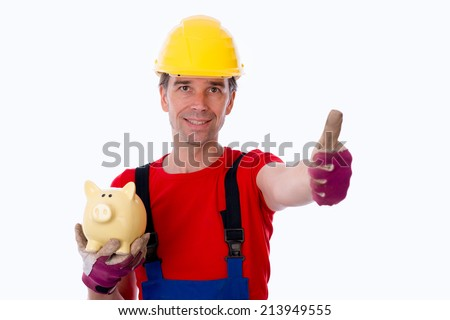 workman with thumb up is showing a piggy bank  - stock photo