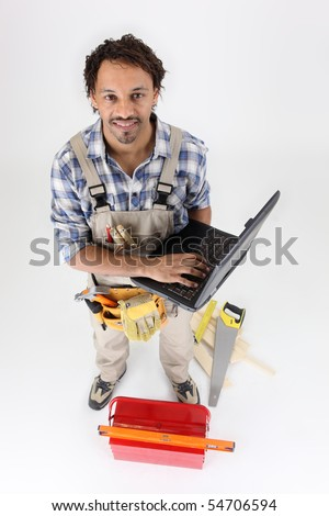 Workman with toolbox and laptop computer on white background