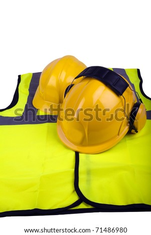 Workmens safety hats and hi-vis jacket isolated - stock photo