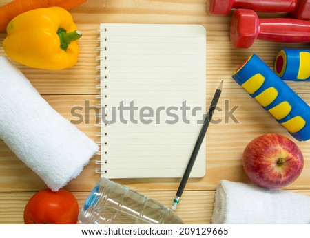 Workout and fitness dieting copy space diary. Healthy lifestyle concept - stock photo