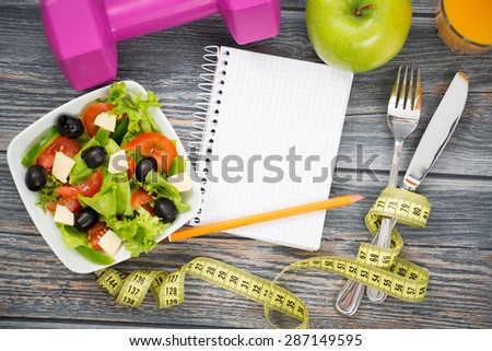 Workout and fitness dieting copy space diary on wooden table. - stock photo