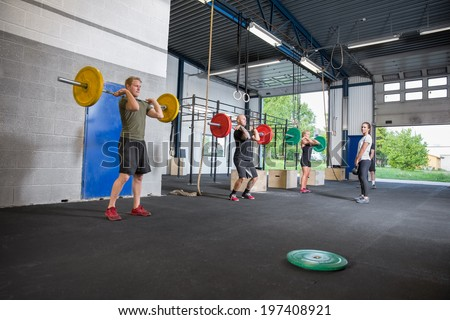 Workout team training at fitness center - stock photo