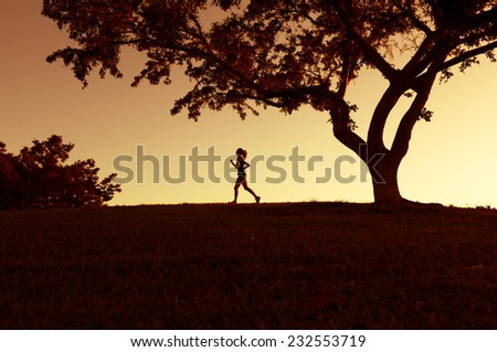 Workout wellness concept - Woman athlete running at the park - stock photo