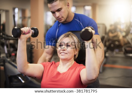Workout with personal trainer - stock photo