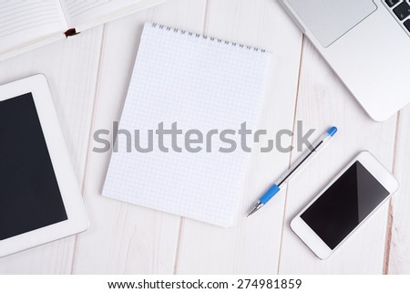 Workplace business still life. laptop, tablet pc, mobile phone, notebook, pen - stock photo