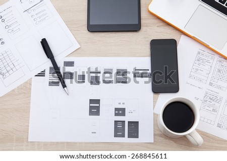 Workplace developer of mobile applications, laptop, notebook, hand, mobile phones and tablets - stock photo