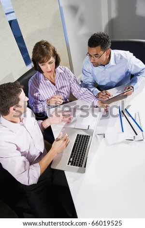 Workplace diversity - multiracial businesspeople working together in boardroom - stock photo