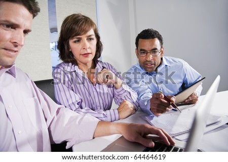 Workplace diversity - multiracial businesspeople working together, main focus on African American man - stock photo