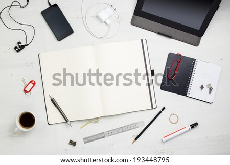 Workplace. Empty notepad, tablet pc and smart phone on white wooden table  - stock photo