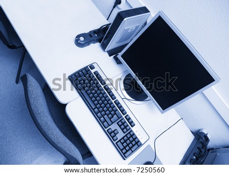 workplace from above with blue tint - stock photo