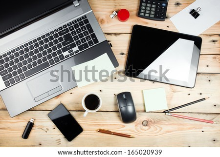 Workplace, laptop and tablet pc on wooden table - stock photo