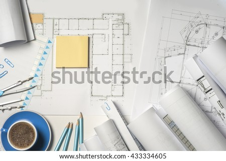 Workplace of architect - Architect rolls and plans.architectural plan,technical project drawing. Engineering tools view from the top. Construction background. - stock photo