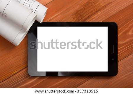 Workplace of architect - Architectural project, blueprints, blueprint rolls and tablet pc or smartphone with empty white screen on wooden table. Engineering tools. Construction background. Top view