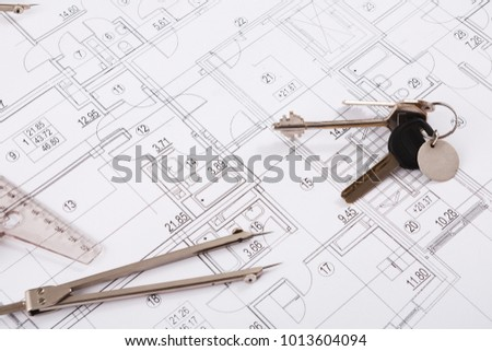 Workplace architect divider keys on blueprint stock photo royalty divider and keys on blueprint creating new architectural project on table malvernweather Gallery