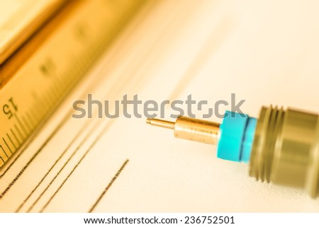 Workplace of engineer, tools for sketching and a drawings. Angle view close-up, in yellow tone - stock photo