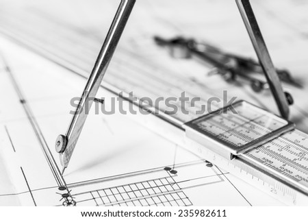 Workplace of engineer, tools for sketching and a drawings. Angle view, in soft tone