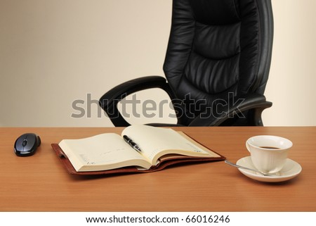 Workplace of the businessman which has just left - stock photo