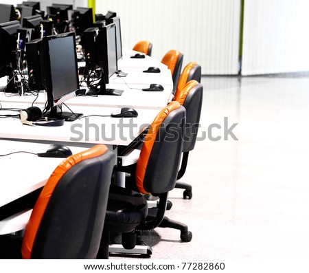 workplace room with computers in row - stock photo