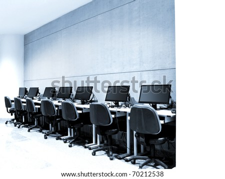 workplace room with computers row - blue tone - stock photo