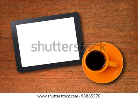 Workplace with blank digital tablet and cup of coffee on work table. Above view shot