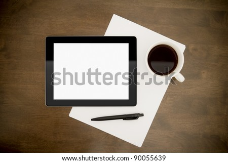 Workplace with blank digital tablet, paper, pen and cup of coffee on work table. Above view shot.